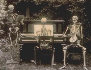 Three skeletons at a piano, 1893, from the National Archives, UK